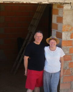 Tony and Tanya Outside Their property